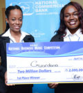 NCU's Guardana team, comprising of Princess Shakes (left) and Natoy Allen pose with winning cheque during the final presentation at the recently held NBMC